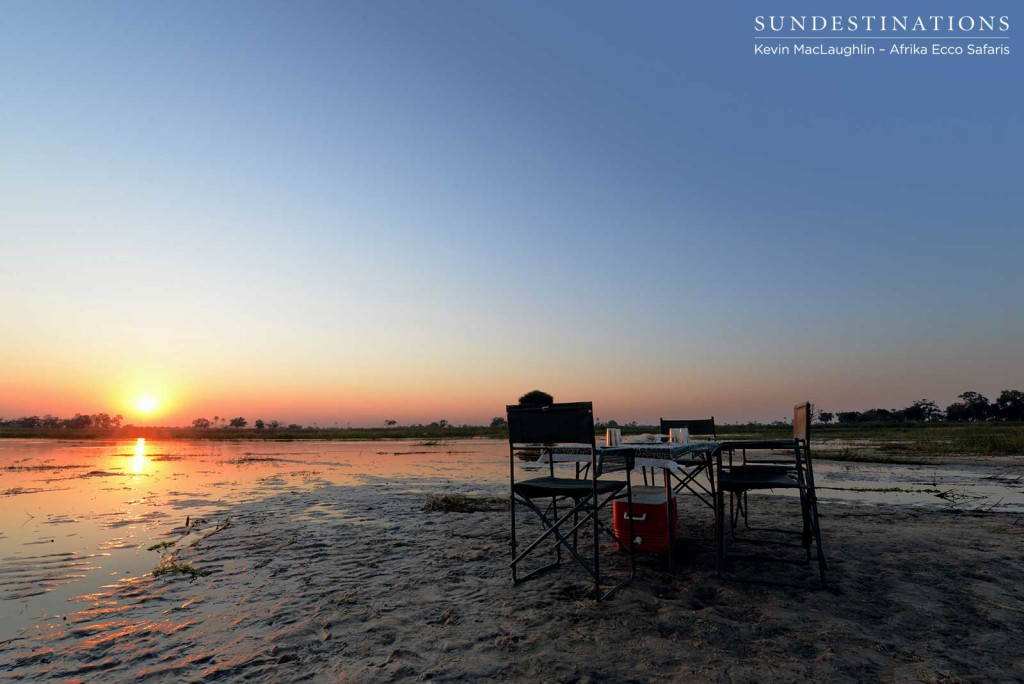 Sundowners on a Delta sand bank await