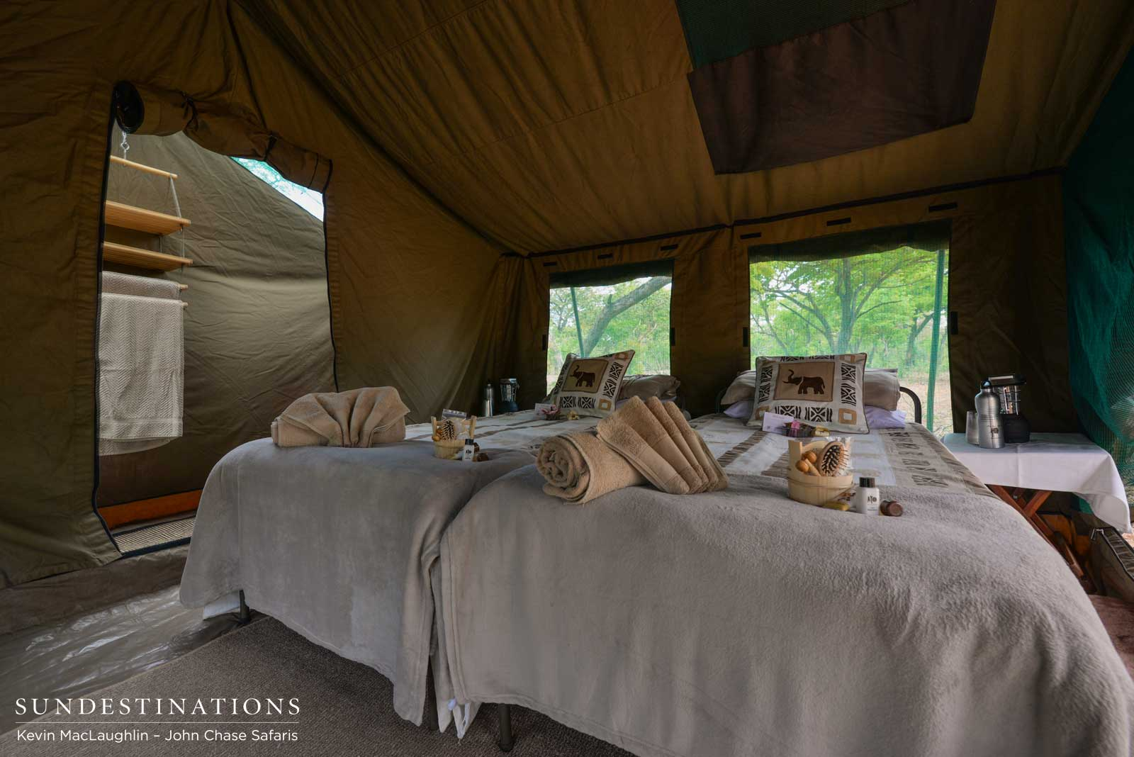Tent interior leading onto en suite bathroom & Luxury Camping in Chobe with John Chase Safaris