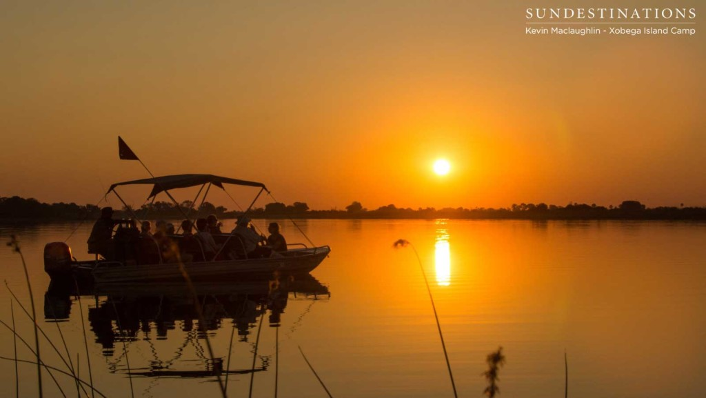 The last burning minutes of the day reflected perfectly in the still waters of the Okavango Delta