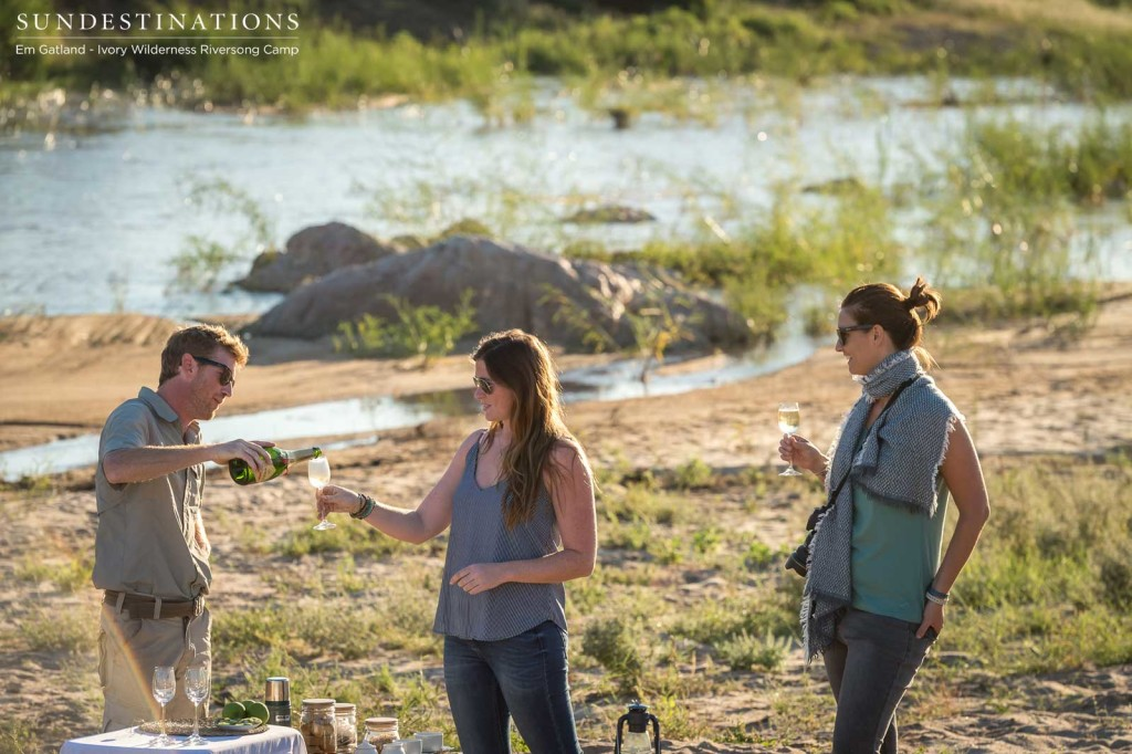 Champagne breakfast on safari at Ivory Wilderness Riversong Camp
